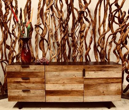natural wood sideboard and liana vine room divider