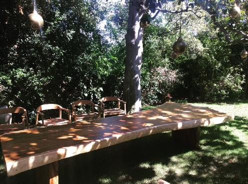 free edge natural wood table outdoors