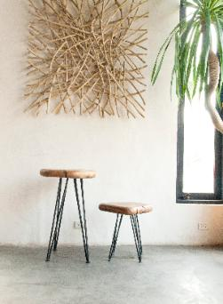 stick wall art and pebble stools