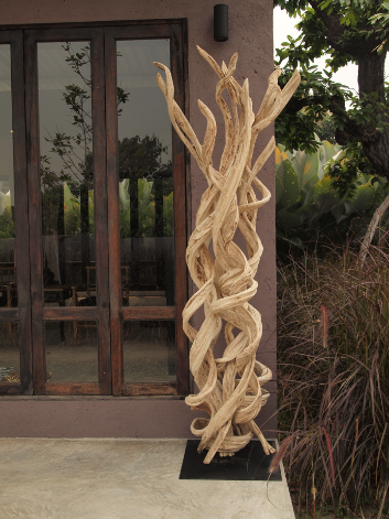 reclaimed tropical vine on stand