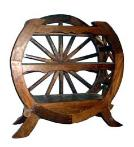 This shelf is made with an old wagon wheel.
