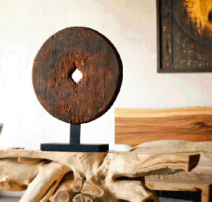 organic console with reclaimed ox cart wheel